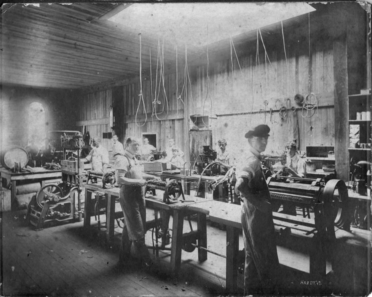 Hardt - men working in a shop, photo by Hardt 1907 - James 'Bud' Hasty closest to camera-fixed